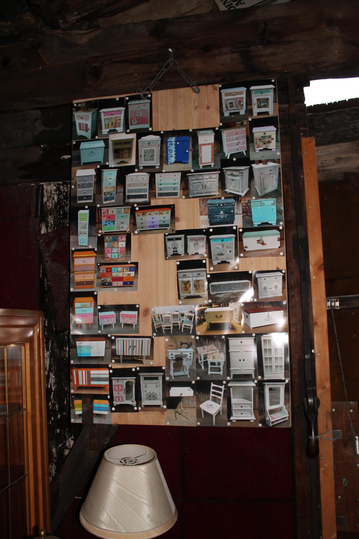 Eine Pinnwand voll Bilder mit verkauften Unikaten!